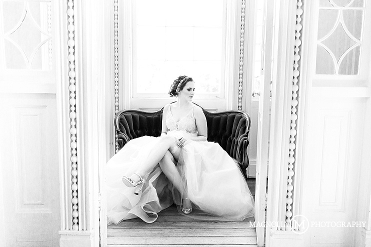 Bride seated in wedding gown with garter