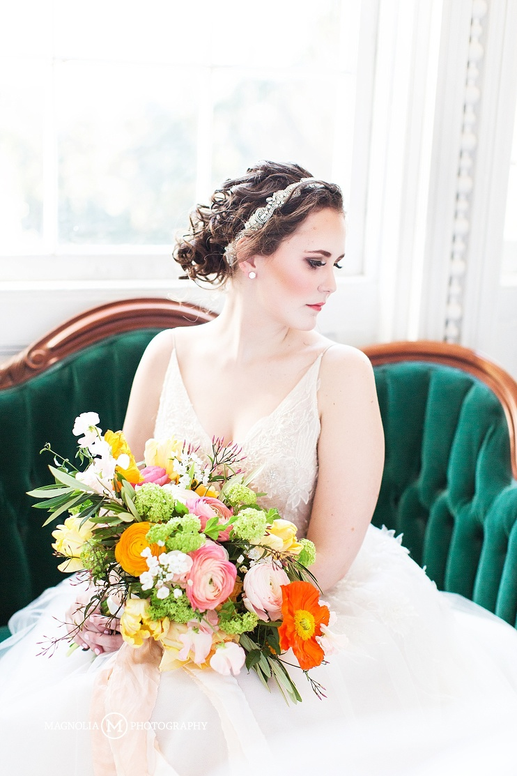Bride seated with bouquet and rhinestone headband