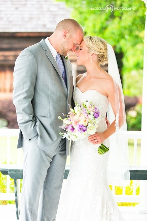 Bride and groom on covered porch