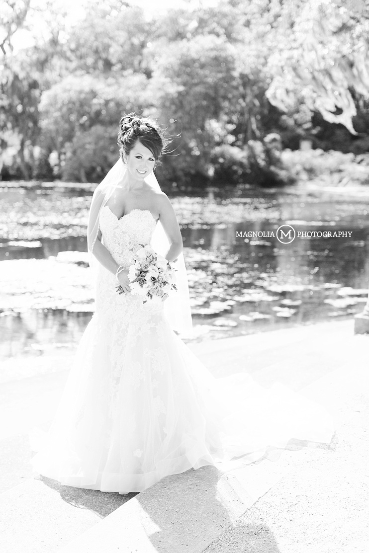 black and white bridal portrait at water