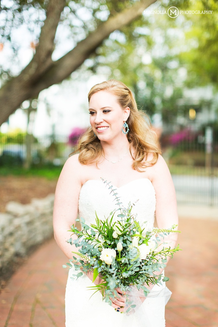 bride with bouquet in strapless lace dress