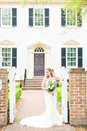 bride in front of beautiful historic home