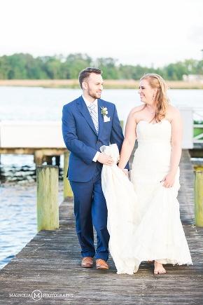 bride and groom walking down the dock
