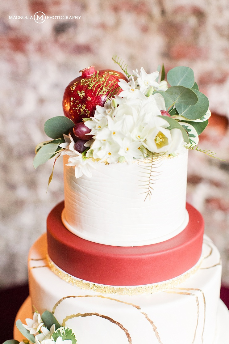 Fall pomegranate cake topper with gold icing