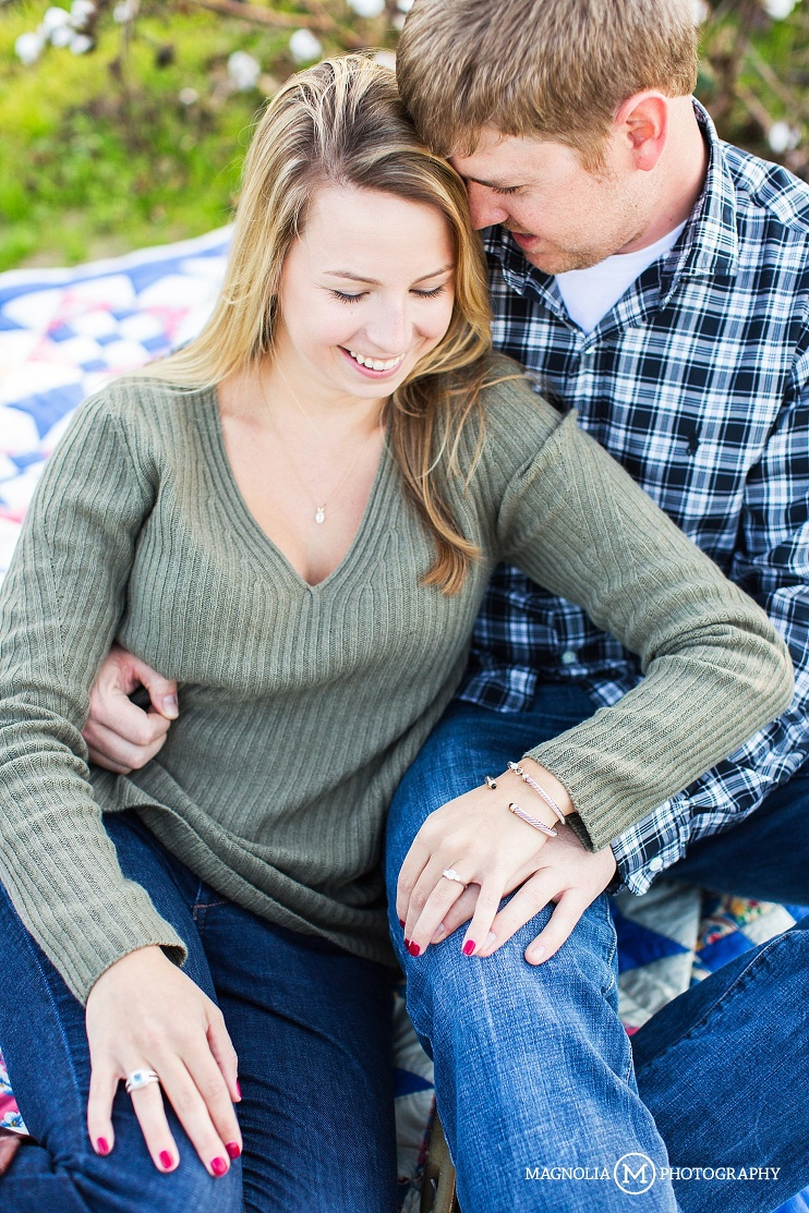 couple on family heirloom quilt
